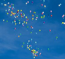 Blue sky with coloured balloons by jacqi