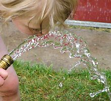 girl drinking from garden hose by MikeStanley