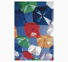 Colourful umbrellas strung up together on a blue sky background  Kids Clothes