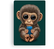 Cute Baby Monkey Holding a Blue Cell Phone  Canvas Print
