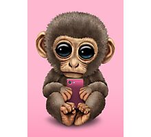 Cute Baby Monkey Holding a Pink Cell Phone  Photographic Print