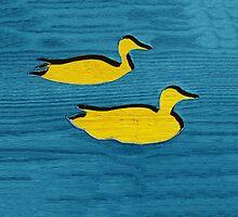 Yellow Ducks in Blue Water by Artosaurus