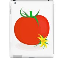 Ripe tomato with green stalk and yellow tomato flower lying near it iPad Case/Skin