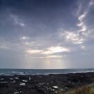 Sunbeams throught the clouds by slugman