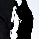 Child Silhouetted on a Climbing Wall by Buckwhite