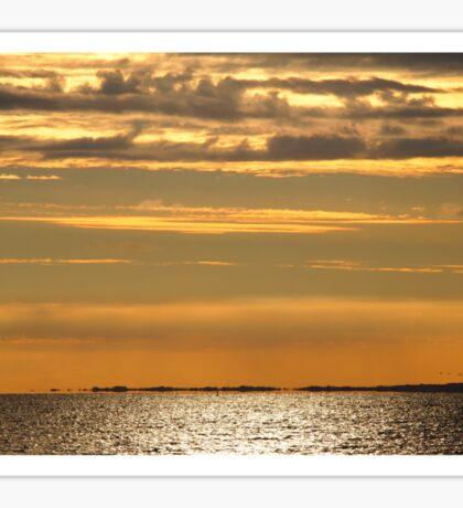 Golden sunset over the ocean Sticker