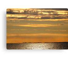 Golden sunset over the ocean Canvas Print