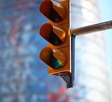 green traffic light in the city by mrivserg