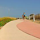 Morning run at Surfside beach, Miami Beach, Florida by Zal Lazkowicz