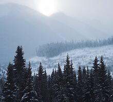 winter sun rising above mountains, near Pemberton , British Columbia by Christopher Barton
