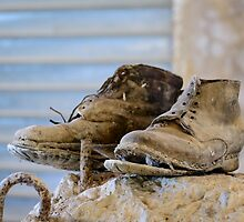 A well worn pair of boots, Bagno Vignoni, Tuscany by Andrew Jones