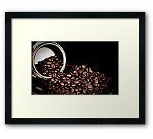Spill the beans. Framed Print