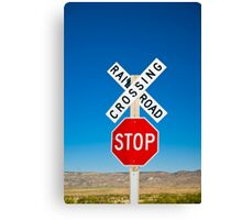 USA. New Mexico. Route 66. near Montoya. Railroad Crossing and sign. Canvas Print