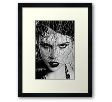 Woman with iron veil Framed Print