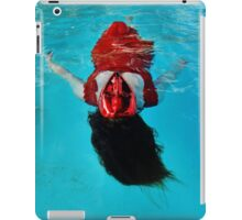 Woman with red mask floats in a pool iPad Case/Skin