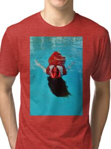 Woman with red mask floats in a pool Tri-blend T-Shirt