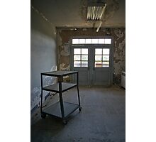 Wheeling shelf in an abandoned hospital Photographic Print