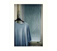 Hanging T-shirt and broken window pane Art Print