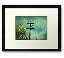 scratches its hammer head against the sky Framed Print