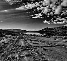 Old broken road by Jordanelle Reservoir in Utah by Alan Mitchell