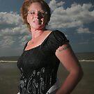 Woman on beach by ArtDambuster