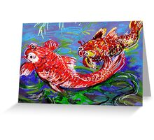 Two goldfish on blue paper. Greeting Card