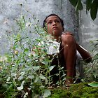 Boy and leaves by Livania de Jesus by Friends  of Suai