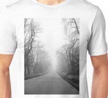 Foggy misty tree lined country road Photographed in the early morning  Unisex T-Shirt