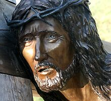 Jesus carrying a cross. by Susan C. Snider