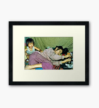 Sad reality; an addicted grandmother and babysitter Framed Print