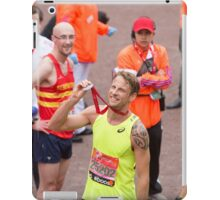 Jenson Button proudly holds his medal at the finish line of the Virgin money London Marathon iPad Case/Skin