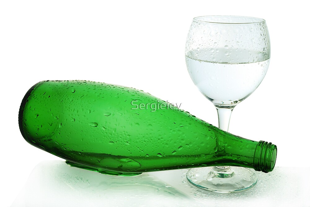 bottle from green glass and wineglass  on white by Sergieiev