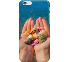 Hands present seashells on the beach first person view  iPhone Case/Skin