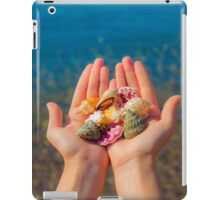 Hands present seashells on the beach first person view  iPad Case/Skin