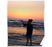 woman holds the sun as it sets in the palm of her hand  Poster