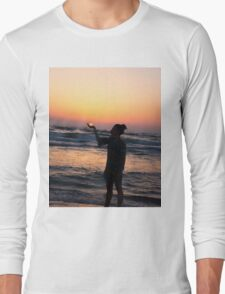 woman holds the sun as it sets in the palm of her hand  Long Sleeve T-Shirt