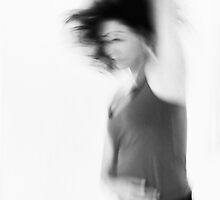 Blurry hyper active young woman  by PhotoStock-Isra