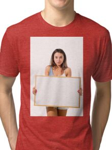 Young model hold a blank whiteboard ready for your text  Tri-blend T-Shirt