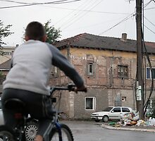 Boy on Bike, South Mitrovica, Kosovo by Christopher Bobyn