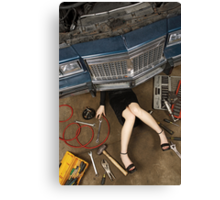 Female mechanic fixing stuff Canvas Print