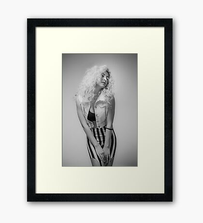 Flirting Young Hip female teen with blond curly hair  Framed Print