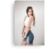 Young teen with long brown hair in jeans and white crop top Canvas Print