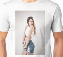 Young teen with long brown hair in jeans and white crop top Unisex T-Shirt