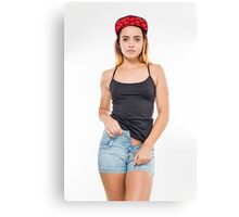 Playful female teen with red baseball cap wearing black top  Canvas Print