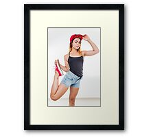 Flexible female teen with red baseball cap wearing black top  Framed Print