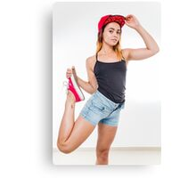 Flexible female teen with red baseball cap wearing black top  Canvas Print