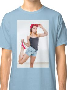 Flexible female teen with red baseball cap wearing black top  Classic T-Shirt