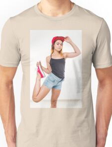 Flexible female teen with red baseball cap wearing black top  Unisex T-Shirt