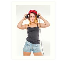 Playful female teen with headphones and red baseball cap wearing black top  Art Print