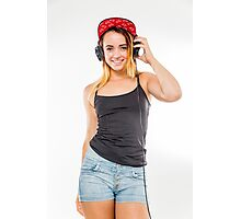 Playful female teen with headphones and red baseball cap wearing black top  Photographic Print